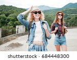 two girls in hats traveling... | Shutterstock . vector #684448300