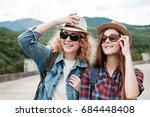 two girls in hats traveling... | Shutterstock . vector #684448408