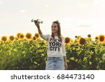 beautiful woman is holding a... | Shutterstock . vector #684473140