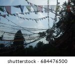 prayer flags at nepalese temple | Shutterstock . vector #684476500