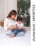 lovely princess is applying the ... | Shutterstock . vector #684487513