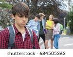 unhappy boy being gossiped... | Shutterstock . vector #684505363
