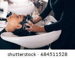 woman applying shampoo and... | Shutterstock . vector #684511528