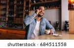 indoor shot of smiling young... | Shutterstock . vector #684511558