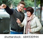 cheerful positive  male tourist ... | Shutterstock . vector #684530944