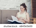 pregnant woman reading book on... | Shutterstock . vector #684565600