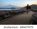 the tourist biking on bike... | Shutterstock . vector #684675370