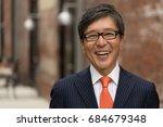 asian businessman in suit smile ... | Shutterstock . vector #684679348