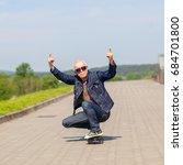 energetic senior man enjoying... | Shutterstock . vector #684701800