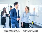 young businesswoman presenting...   Shutterstock . vector #684704980
