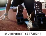 back view of men's feet on... | Shutterstock . vector #684725344