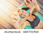 Stock photo she loves sport top view of beautiful and young woman in sports clothing making heart with her 684741964