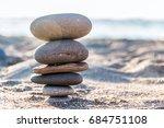 the stones on the sea shore are ... | Shutterstock . vector #684751108