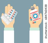 doctor hands holds capsules ... | Shutterstock .eps vector #684760438