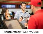 attractive couple buying... | Shutterstock . vector #684792958