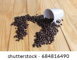 coffee beans placed on a white... | Shutterstock . vector #684816490