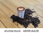 coffee beans placed on a white... | Shutterstock . vector #684816628
