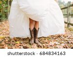 Bride Wears Cowboy Boots For...