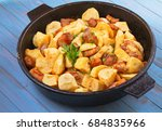 pan fried potato and meat | Shutterstock . vector #684835966