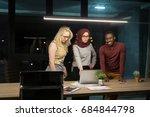 colleagues working overtime in... | Shutterstock . vector #684844798