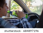 young man drinking beer while... | Shutterstock . vector #684897196