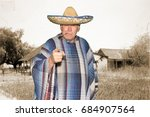 A Man Wears A Sombrero And A...