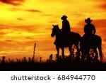 cowboy on horseback. ranch | Shutterstock . vector #684944770
