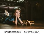 cute dreamer boy playing with... | Shutterstock . vector #684968164