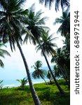 Small photo of Sea and coconut palm trees - Beautiful landscape - Beach at Khanom ,Nakhon Si Thammarat Thailand ( Gulf of Thailand )