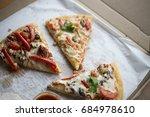 delicious pizza in a box | Shutterstock . vector #684978610