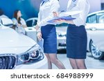 salesperson selling cars at car ... | Shutterstock . vector #684988999