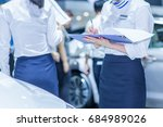 salesperson selling cars at car ... | Shutterstock . vector #684989026