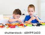 two child boy play repair toys | Shutterstock . vector #684991603