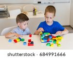 two child boy playing with... | Shutterstock . vector #684991666