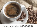 hot cup of coffee with coffee... | Shutterstock . vector #685008154