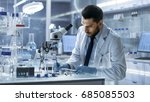 research scientist writes down... | Shutterstock . vector #685085503