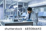 research scientist writes down... | Shutterstock . vector #685086643