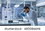 research scientist looks into... | Shutterstock . vector #685086646