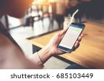 closeup woman hand holding... | Shutterstock . vector #685103449