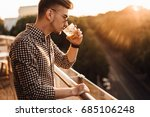 stylish man sit on the table... | Shutterstock . vector #685106248
