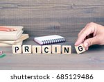 Pricing. wooden letters on dark ...