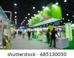 Small photo of Abstract blur people in trade show expo background