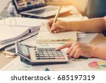 woman hand using calculator and ... | Shutterstock . vector #685197319