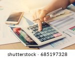 woman hand using calculator and ... | Shutterstock . vector #685197328