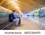 young man waiting and using... | Shutterstock . vector #685236493