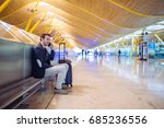 young man waiting and using... | Shutterstock . vector #685236556