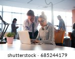 two business people using... | Shutterstock . vector #685244179