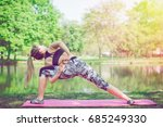 young woman practicing yoga | Shutterstock . vector #685249330