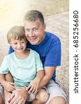 father and son cuddling on the... | Shutterstock . vector #685256680