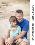 father and son cuddling on the... | Shutterstock . vector #685256698